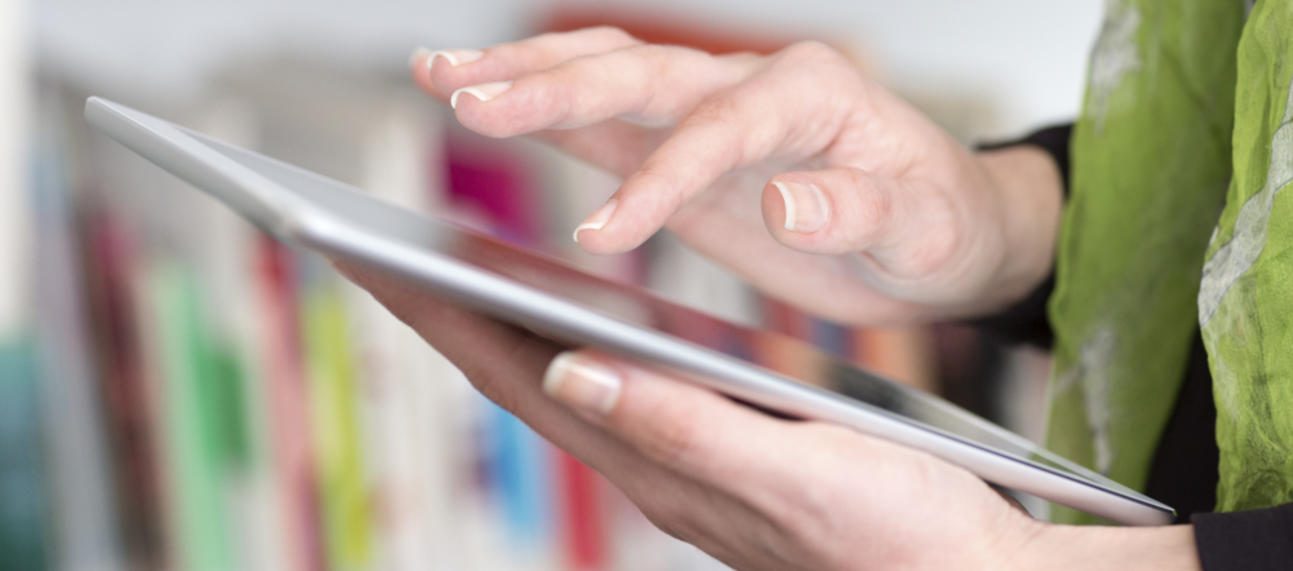 young woman hand holding a tablet pc
