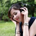 Person listening to headphones outdoors
