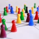 Colourful plastic game pieces on a board (image by Pixabay on Pexels)
