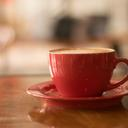 Cappuccino in a red teacup