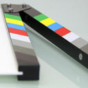 Filming clapboard lying on a flat surface