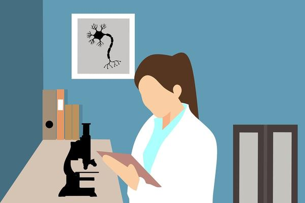 Researcher with microscope reading notes
