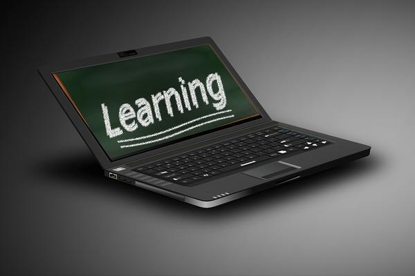 'Learning' written on a laptop monitor