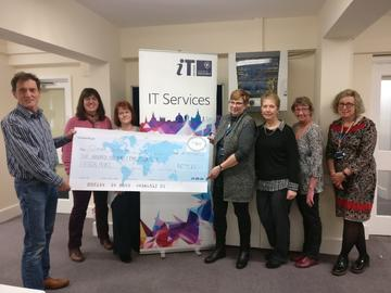 Knitters United present 2019 fundraising proceeds to Kevin Byrne from The Gatehouse